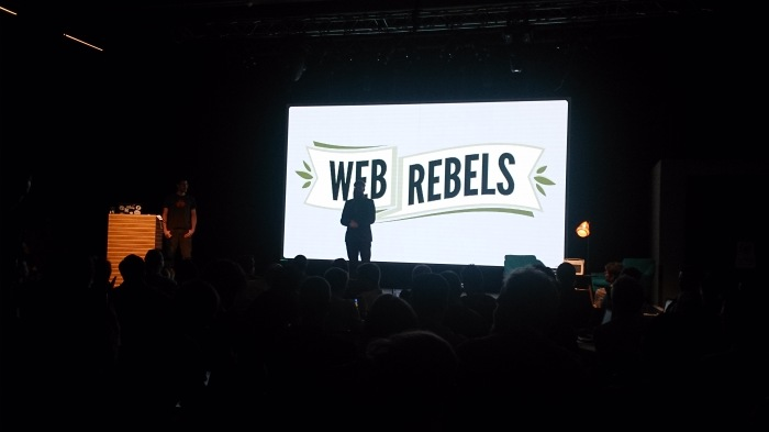 Webrebels conference. Opening slide on stage.